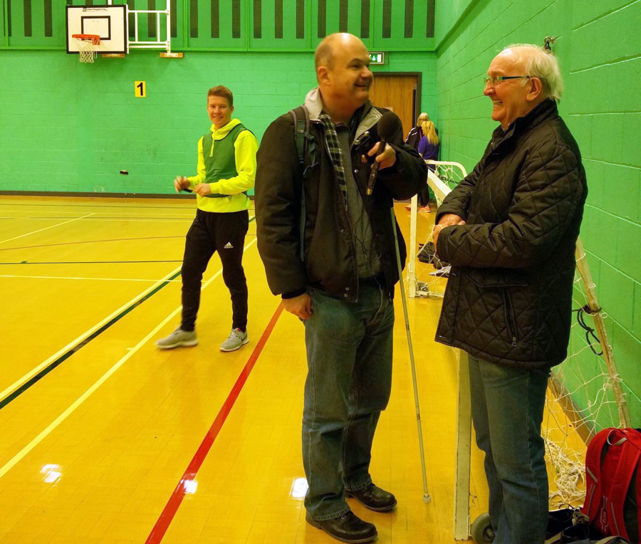 Tom Walker interviewing former Burnley footballer, Willie Irvine, about a new walking football initiative in the town.